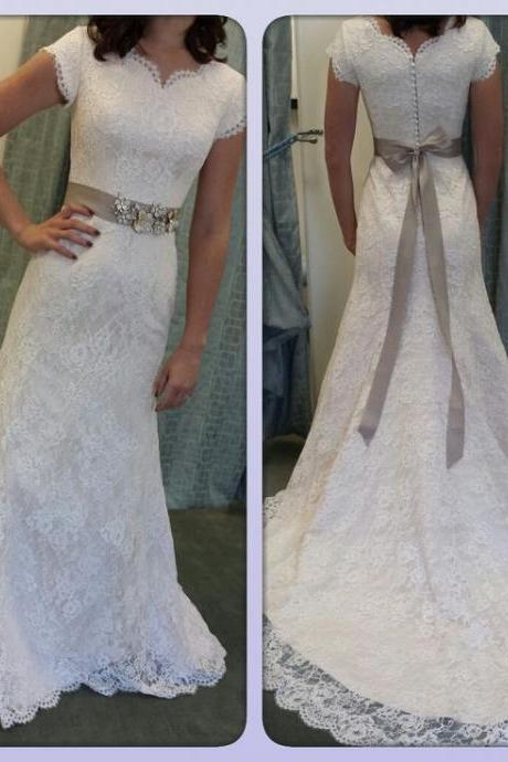 Lace Mermaid Wedding Gown with Cap Sleeves and Beaded Sash